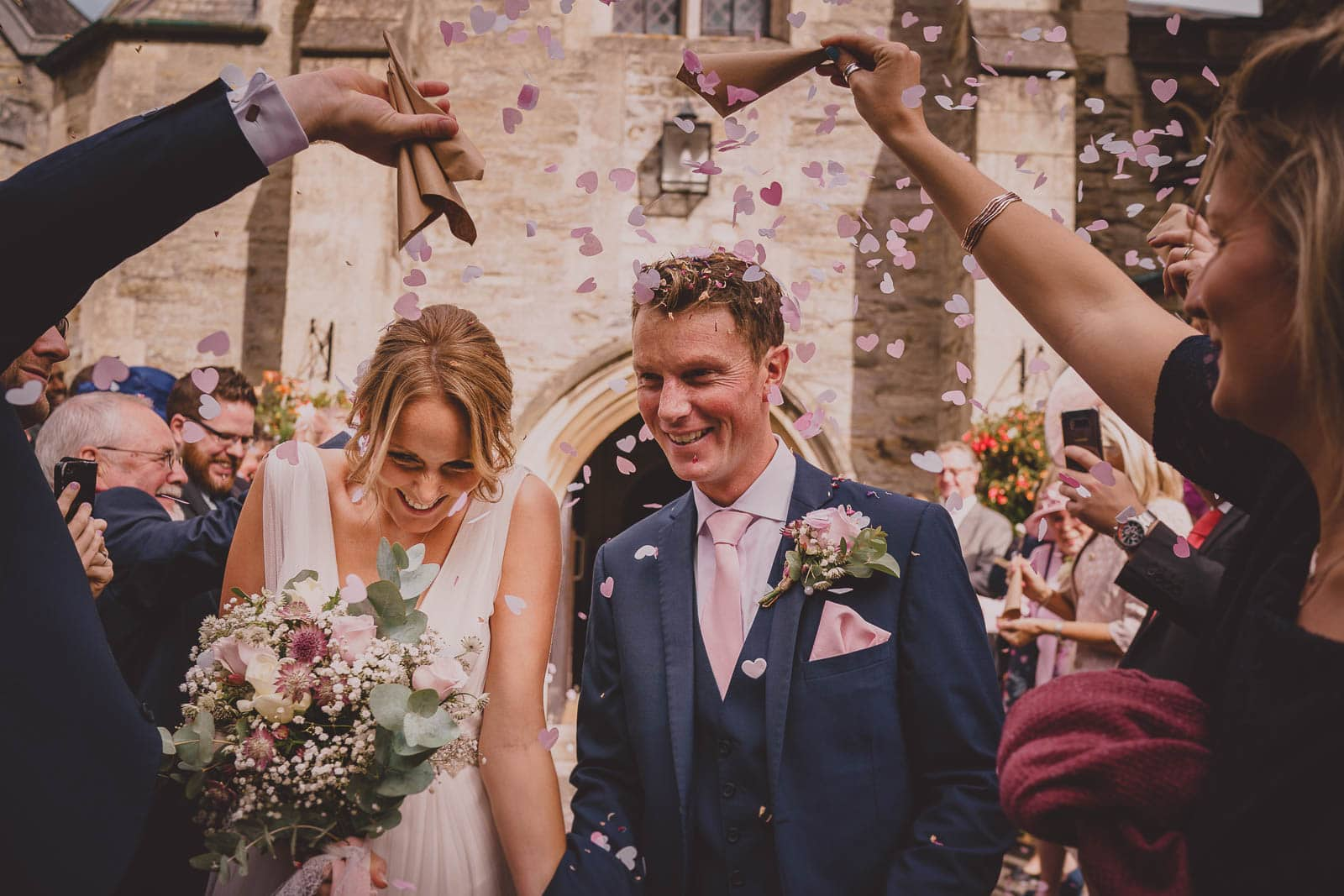 An image of wedding confetti being thrown at Alverton Manor.