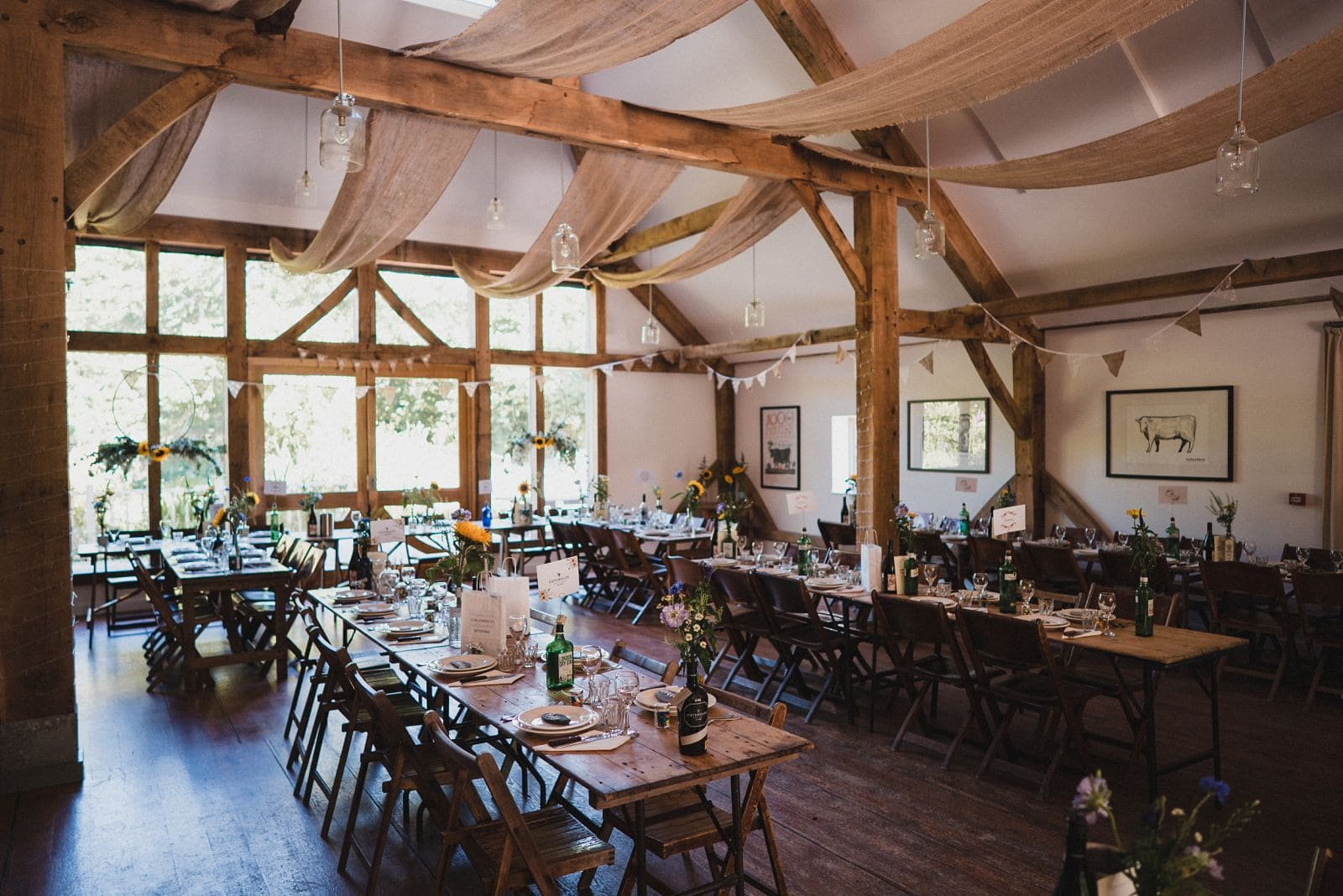 Nancarrow Farm's Oak Barn laid up with trestle tables for a wedding breakfast