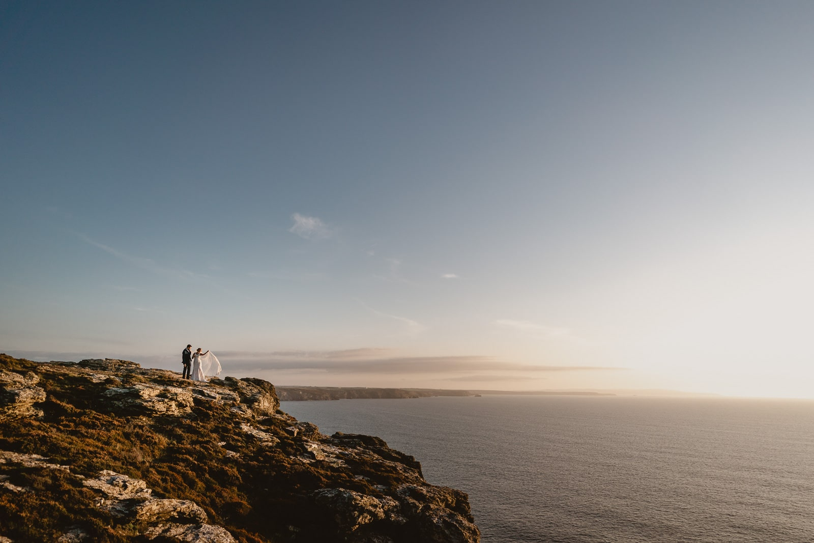 A portrait of a bride and groom on the coastline by Newdowns Farm.