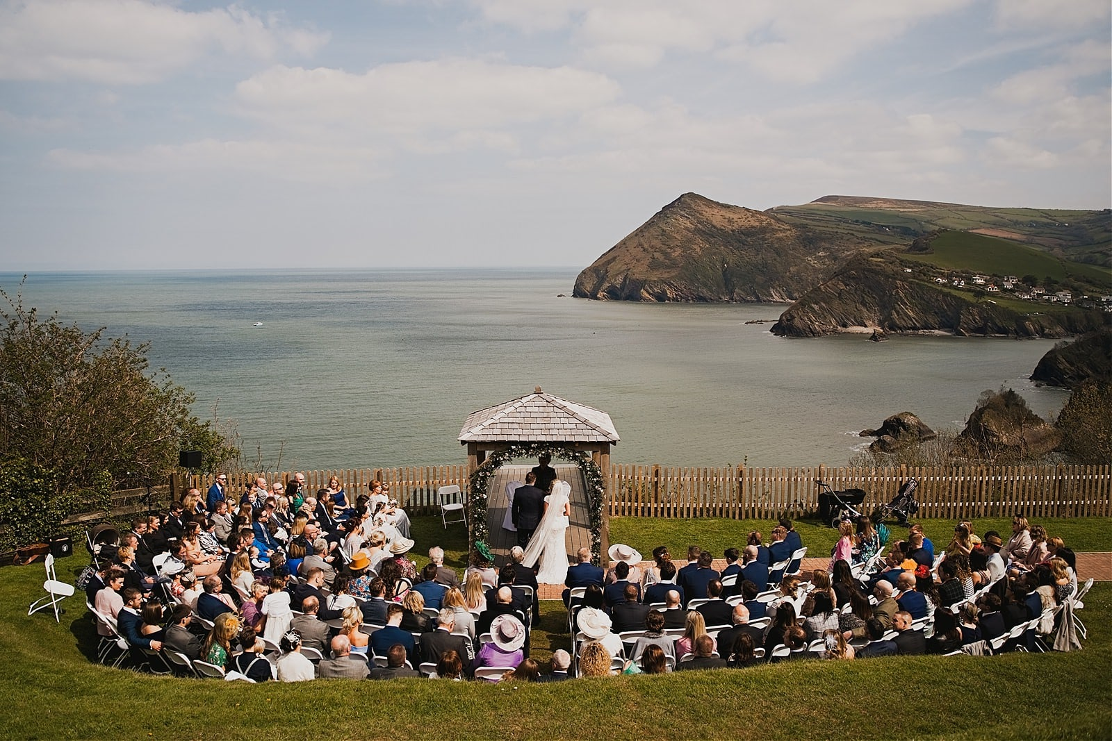 Wedding Ceremony at Sandy Cove Hotel with wide views to the coast