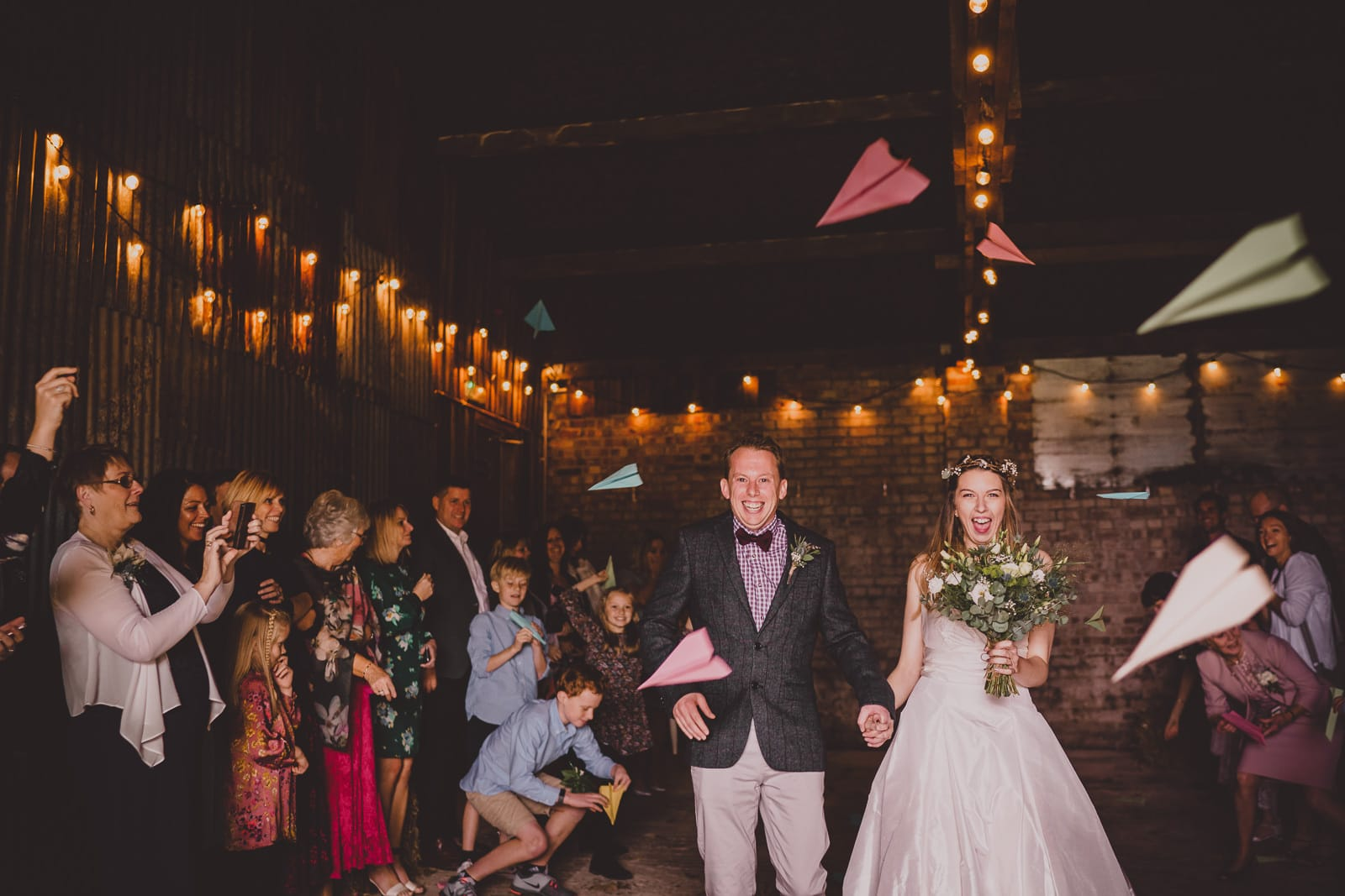 Wedding confetti (paper aeroplanes) in the Really Rustic Barn at The Green.