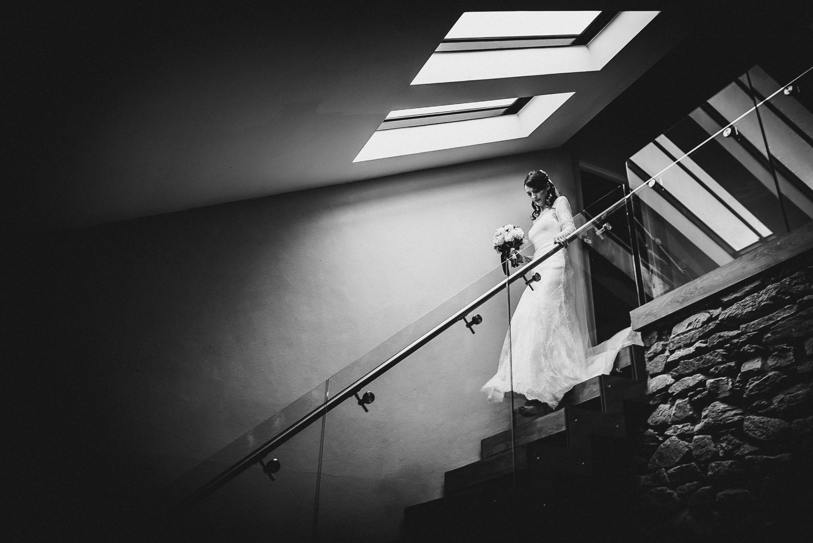 Bride descending stairs at Trevenna