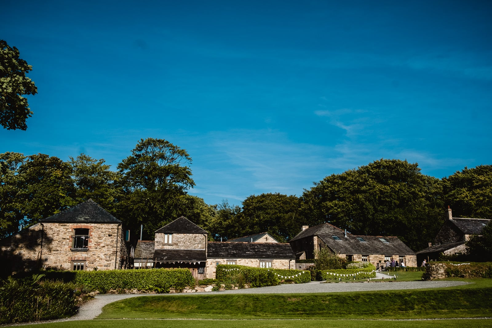 A wide shot of the barns, garden venue and cottages at Trevenna