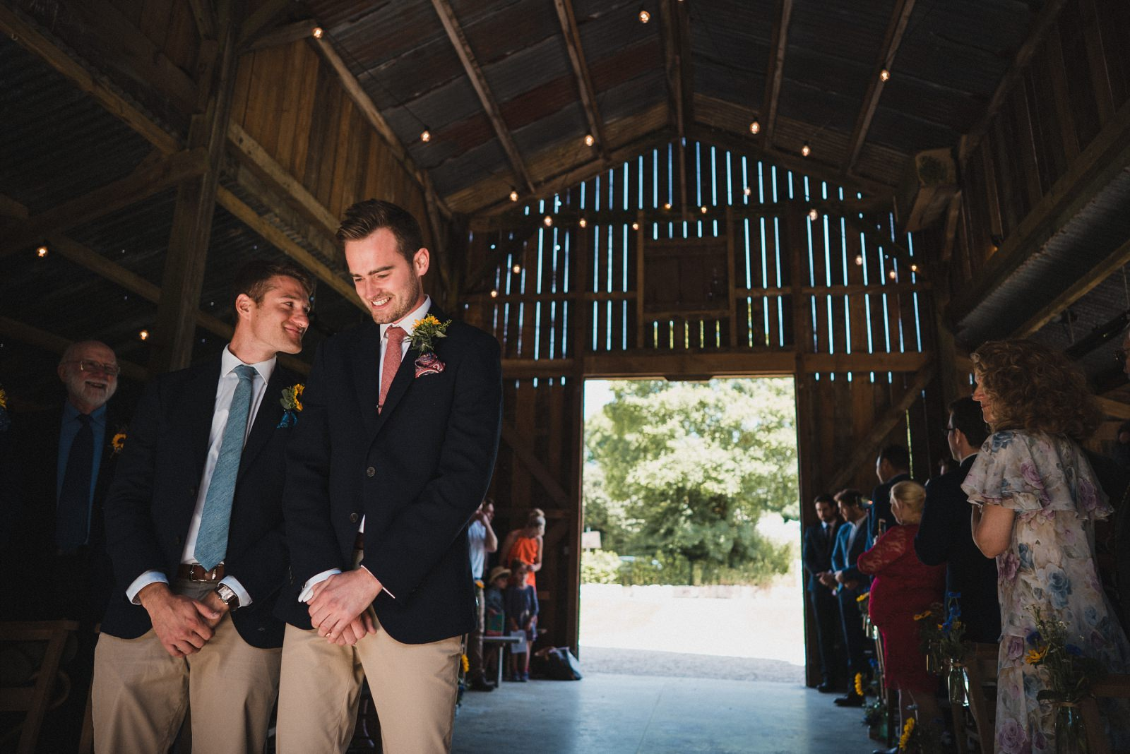 The groom nervously waiting for his bride to walk in to their wedding ceremony at Nancarrow Barn.