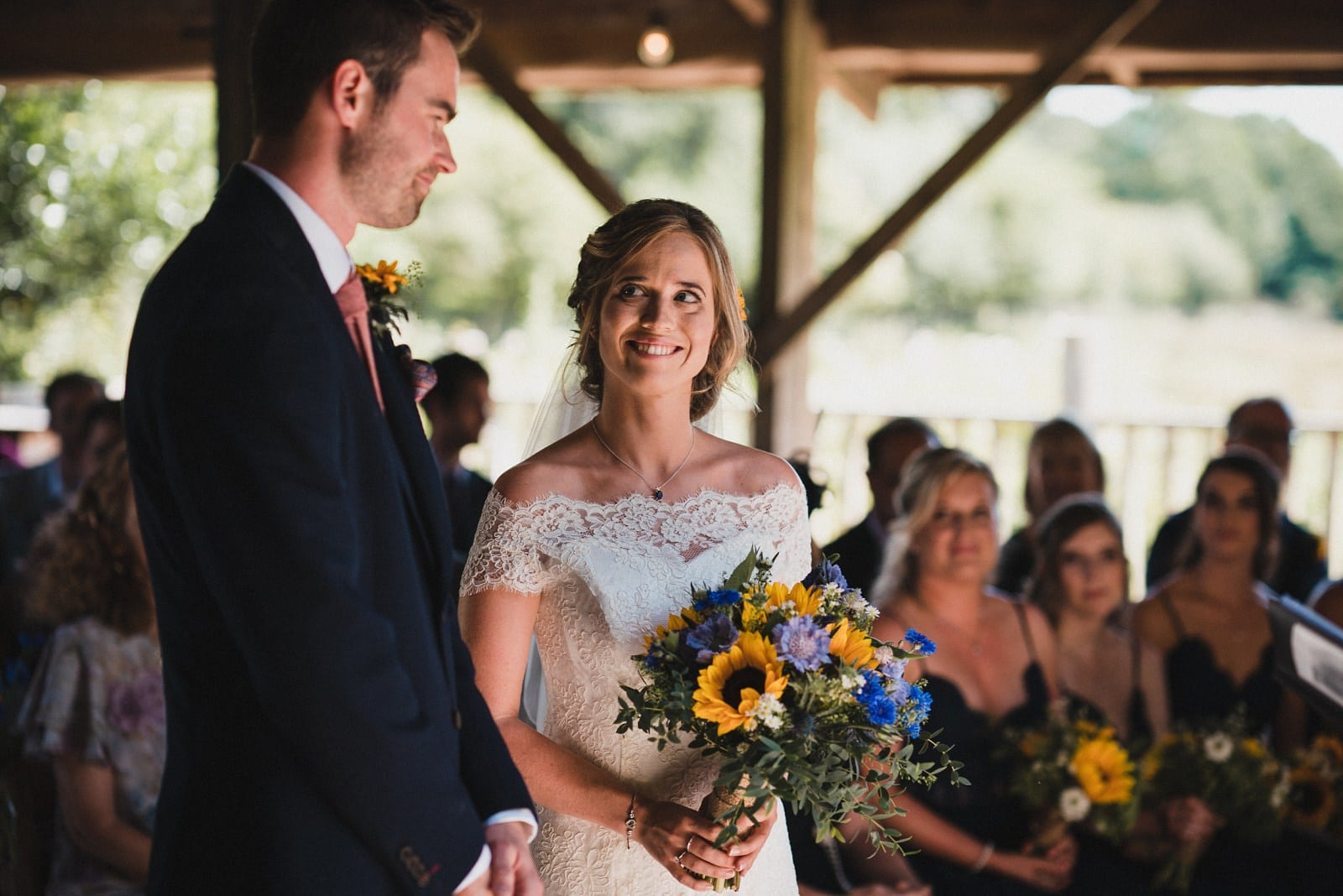 Bride looking lovingly at her groom during their wedding ceremony at Nancarrow Farm