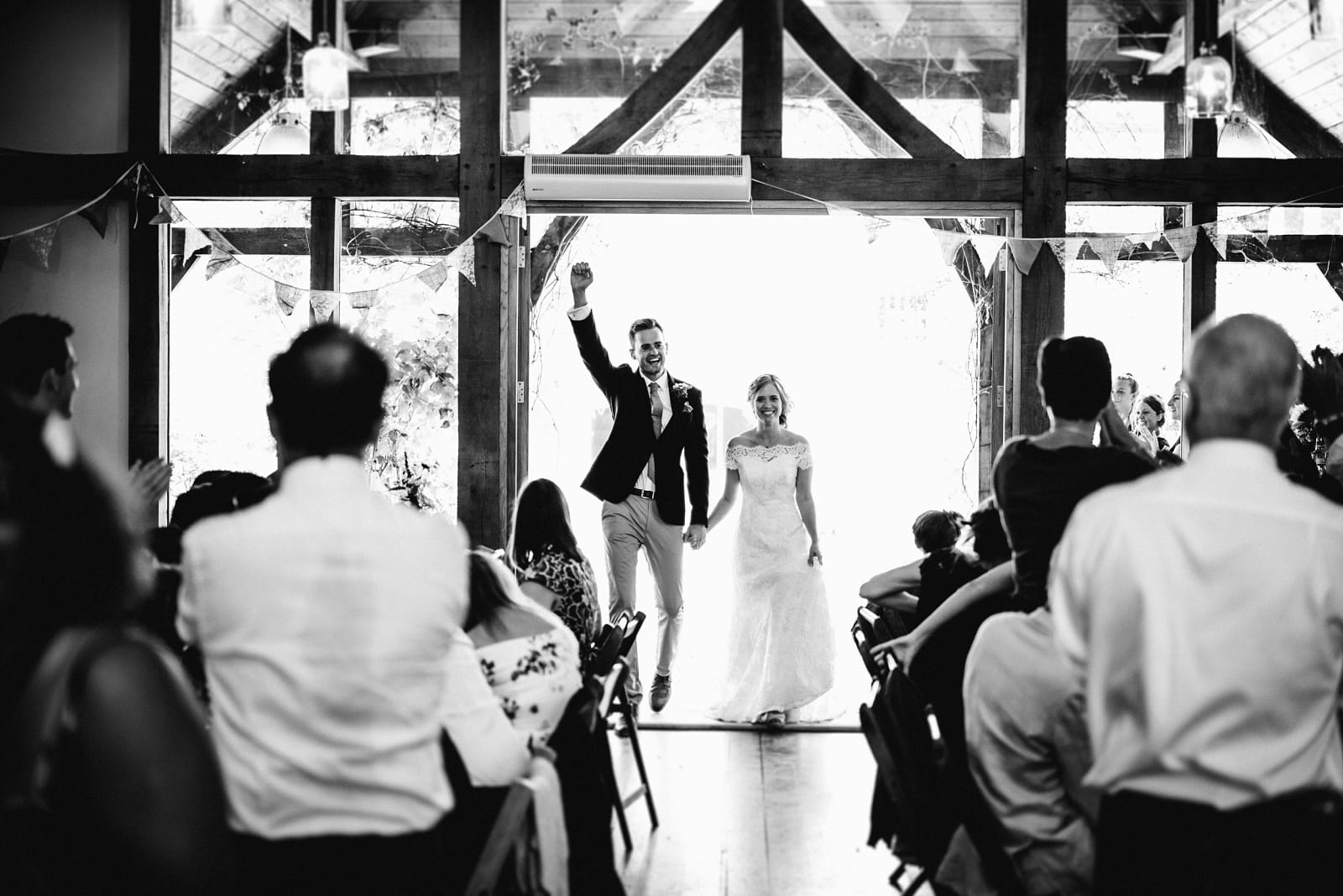The couple enter the Oak Barn at Nancarrow Farm for their wedding breakfast