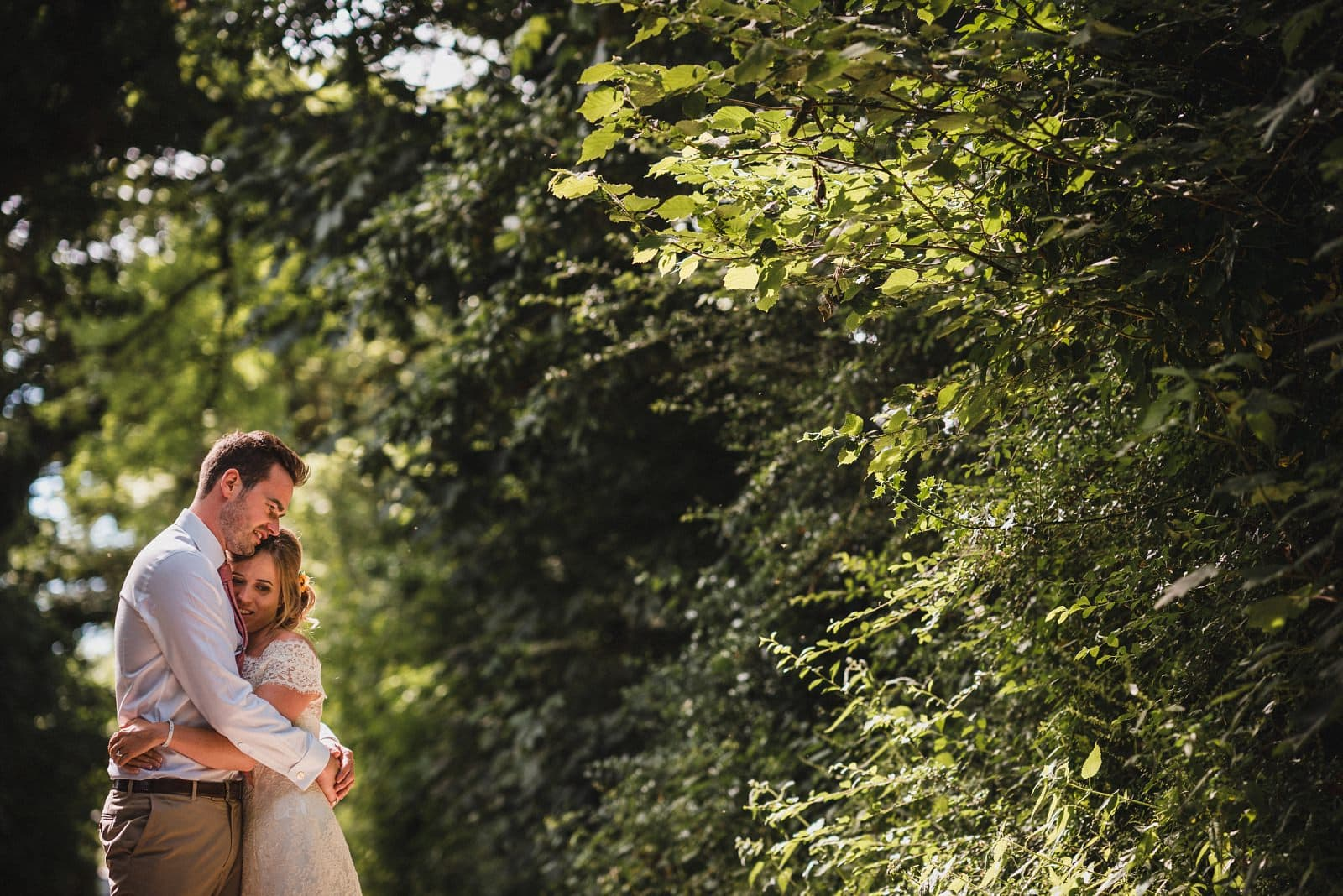 A photograph of a couple hugging on their wedding day at Nancarrow Farm