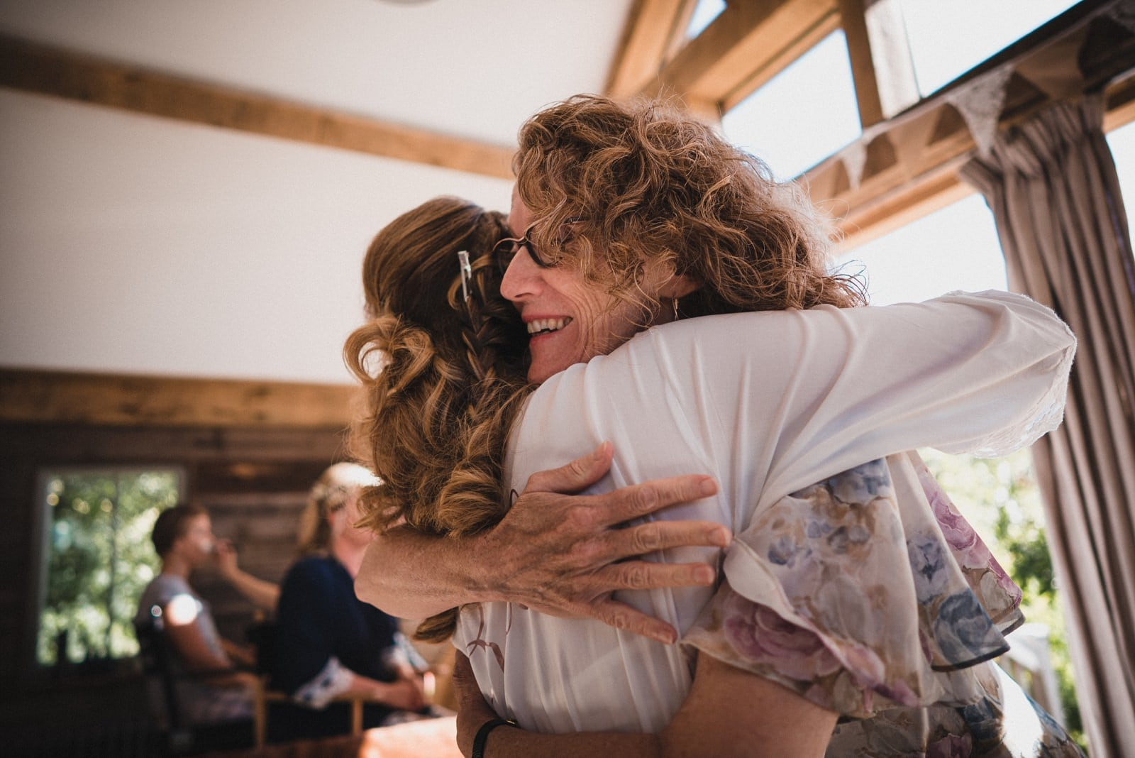 The bride getting a a huge hug during bridal preparations at Nancarrow Farm
