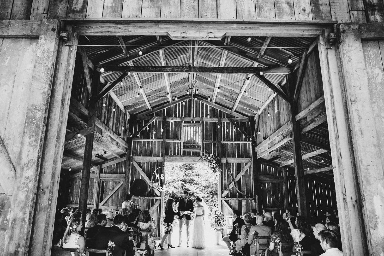 The bride and groom receive their wedding certificate in the Rusty Barn at Nancarrow Farm
