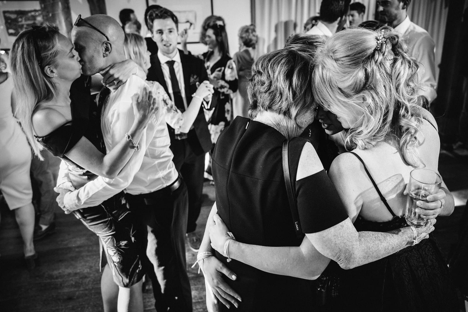 Hugs between wedding guests on the dancefloor at Nancarrow Barn