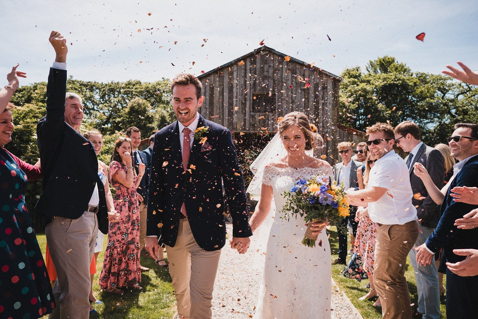 Wedding confetti run photographed at Nancarrow Farm