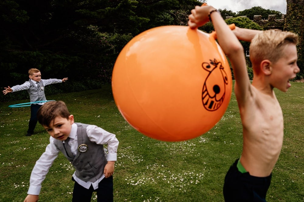 colourful photograph of children playing at wedding in cornwall