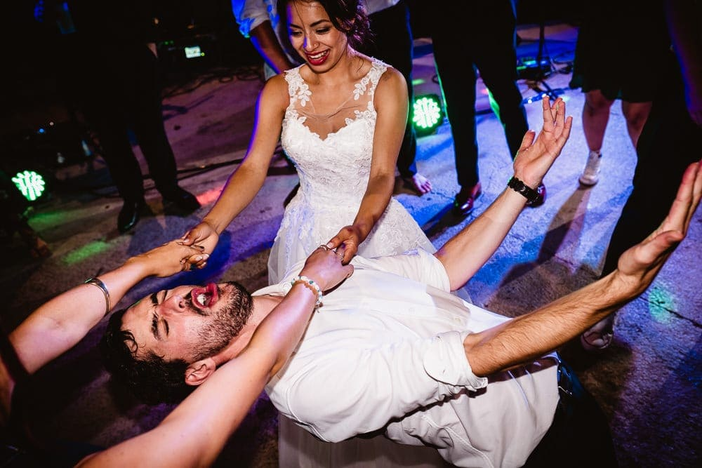 wedding photograph of dancefloor limbo with bride