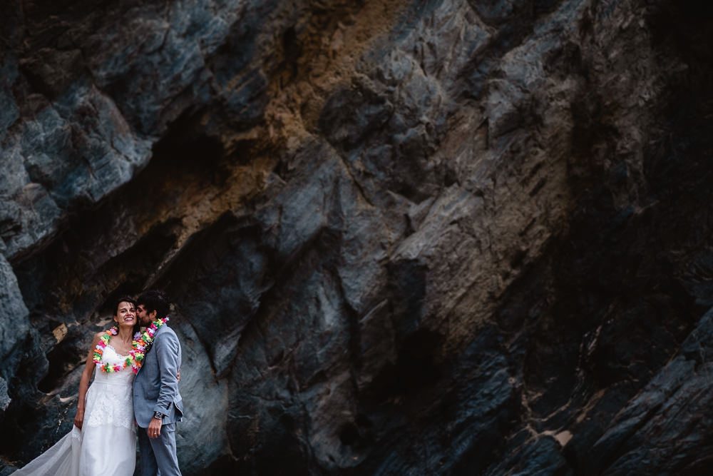 Elopement couple in front of cliffs